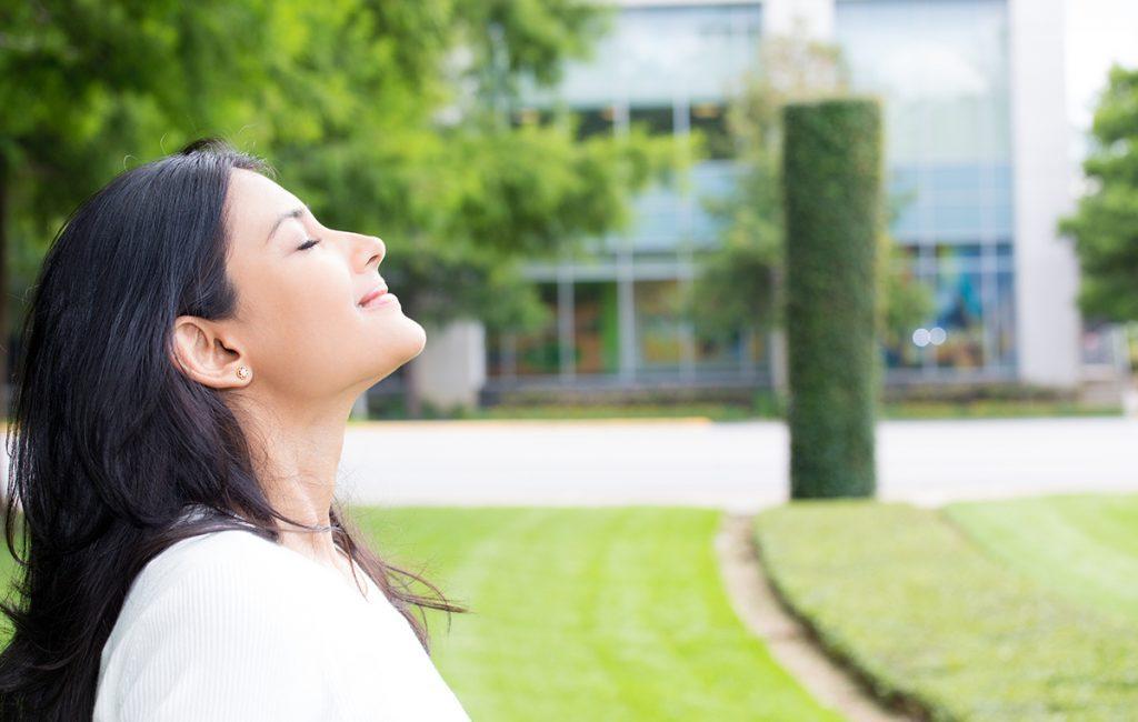 complete wellbeing: girl breathing in fresh air