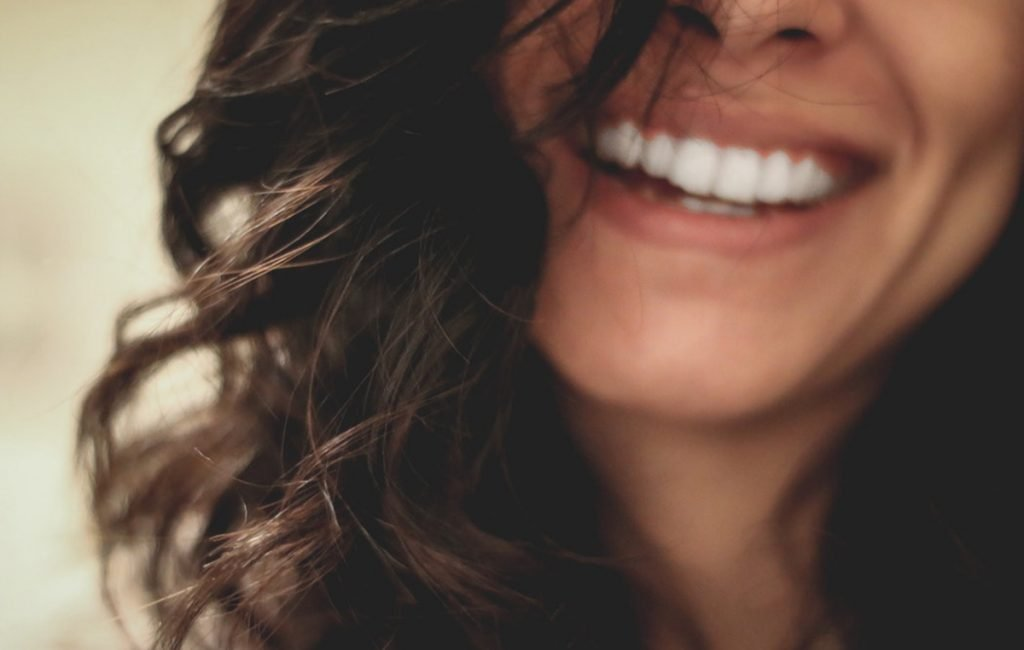 complete wellbeing: close-up of woman smiling