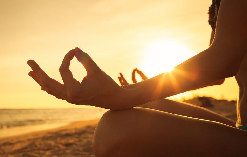 wellbeing: girl soaking sunshine at the beach