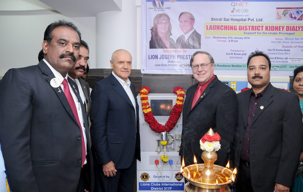 QNET India and Lions Club officials donating a Kidney Dialysis Unit in Banglore