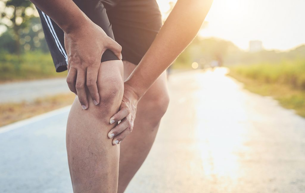 Osteoporosis: Man holding his painful knee