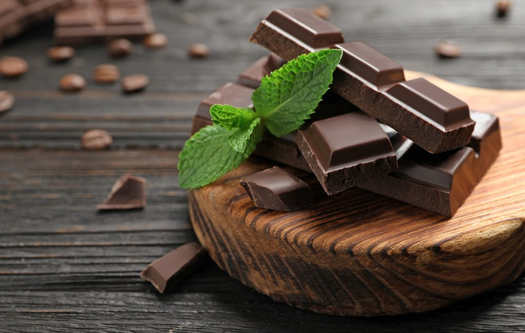 Immunity-boosting foods: dark chocolate on a board