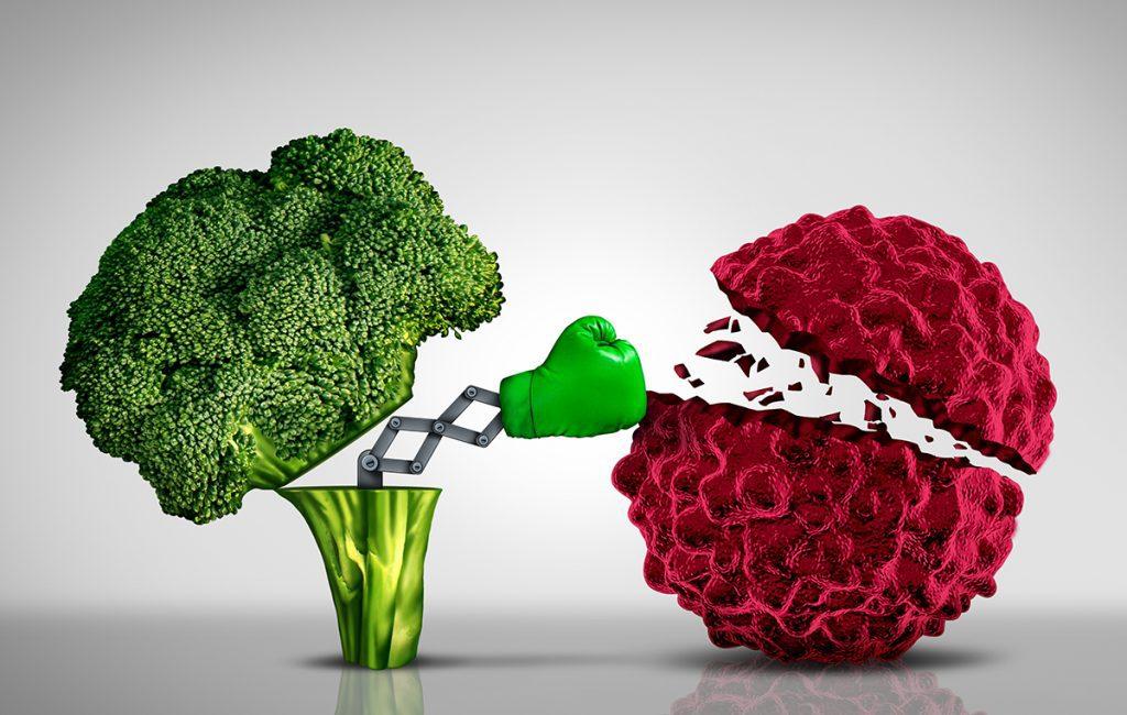 Immunity-boosting foods: a broccoli stem punching a germ