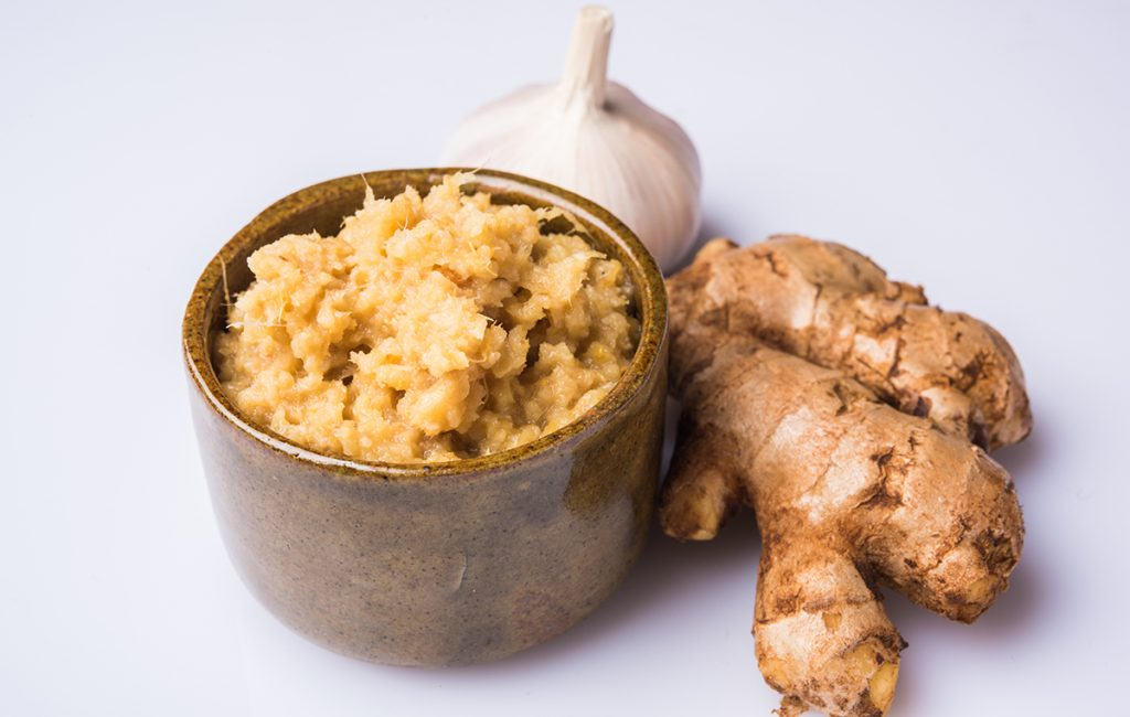 Immunity-boosting foods: a cup of ginger paste with a clove of garlic