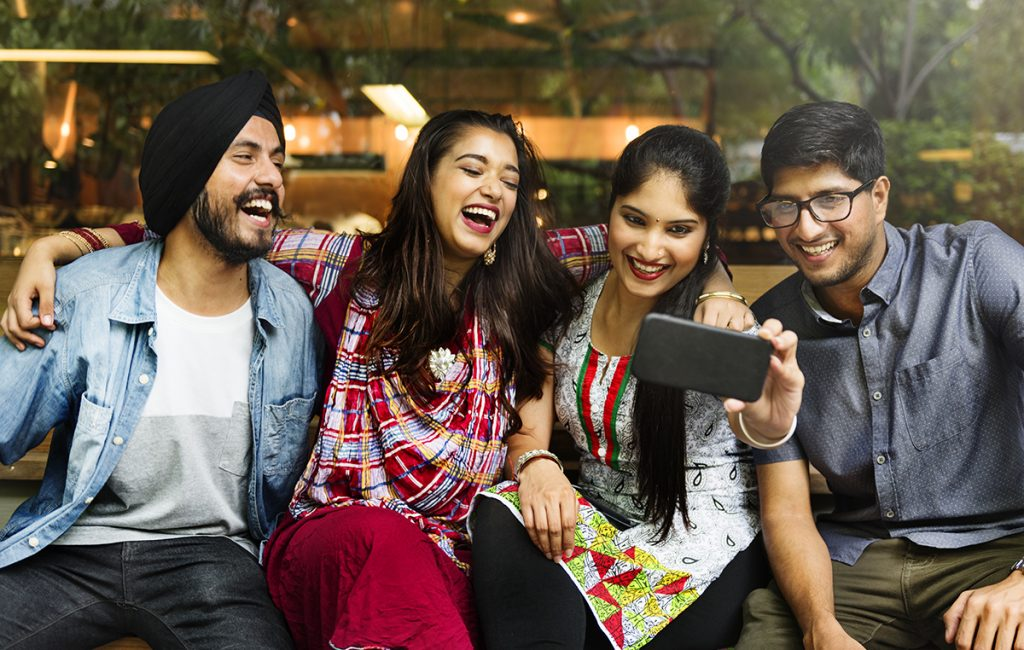 Friendship Day 2019: Male and female friends laughing and clicking a selfie