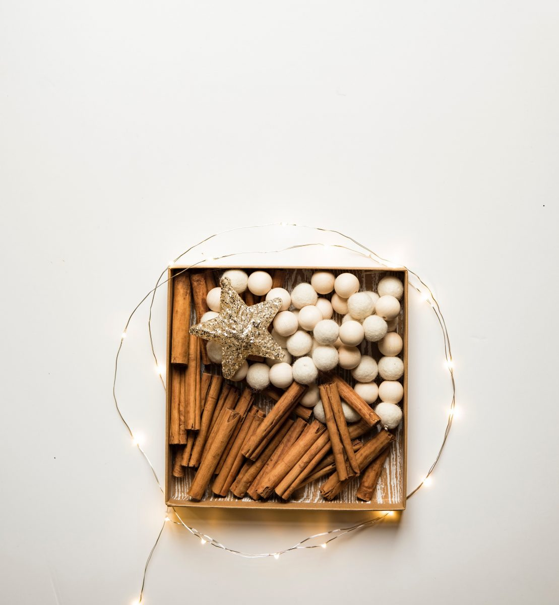 Cinnamon: Cinnamon sticks in a display with fairy lights and decorative objects