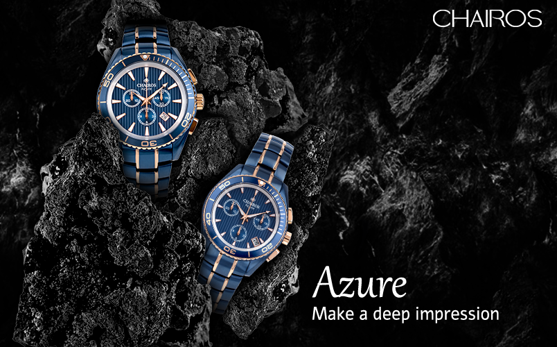 CHAIROS Azure watches emerging from a fossil with a black background.