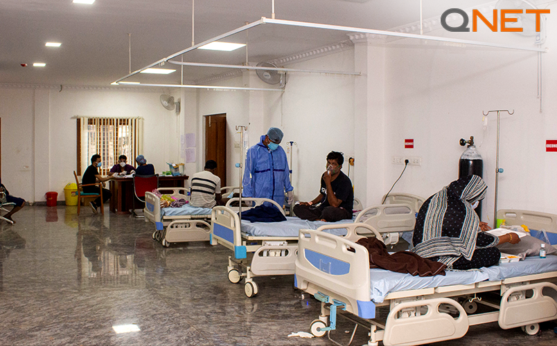 COVID-19 patients being treated by doctors in the COVID Care Hospital through Project CoHeal by QNET India.